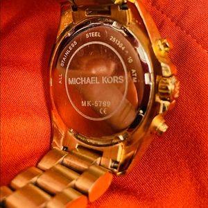 Women's Rose Gold metal watch.